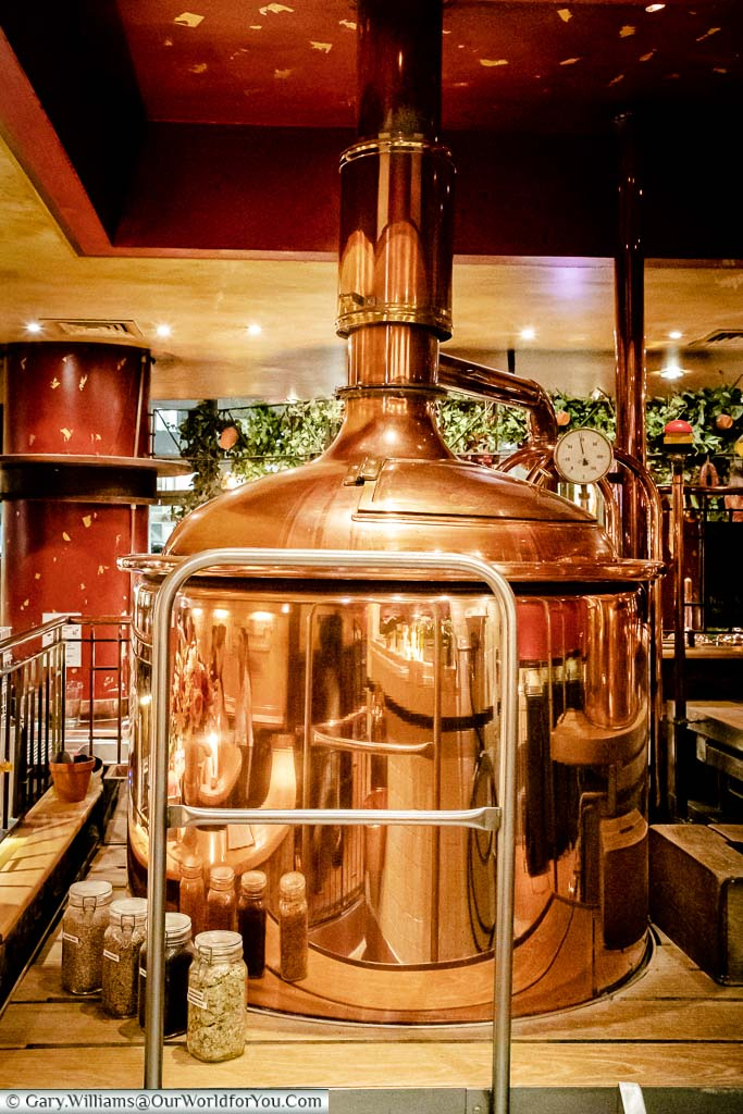 A large brightly polished copper Mash Tun at the Joh Albrecht brewhouse in Hamburg.