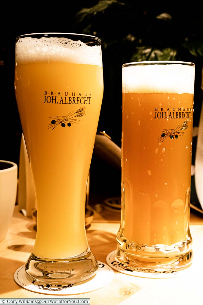 Two large glasses of cloudy beer from the Joh Albrecht Bauhaus in Hamburg