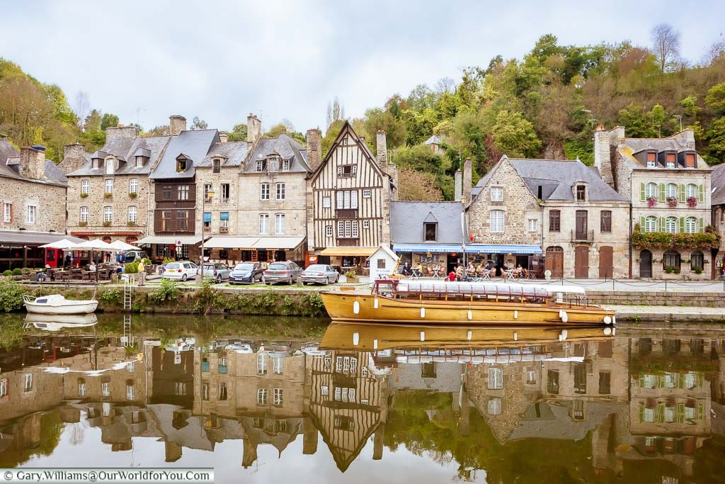 A boat moored up alongside the quay in Dinan in front of bars & restaurants