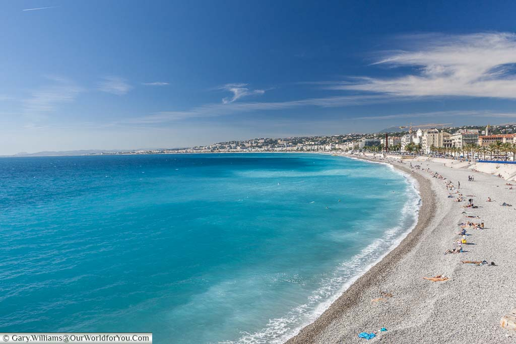 The beach and azure blue water of Nice, France