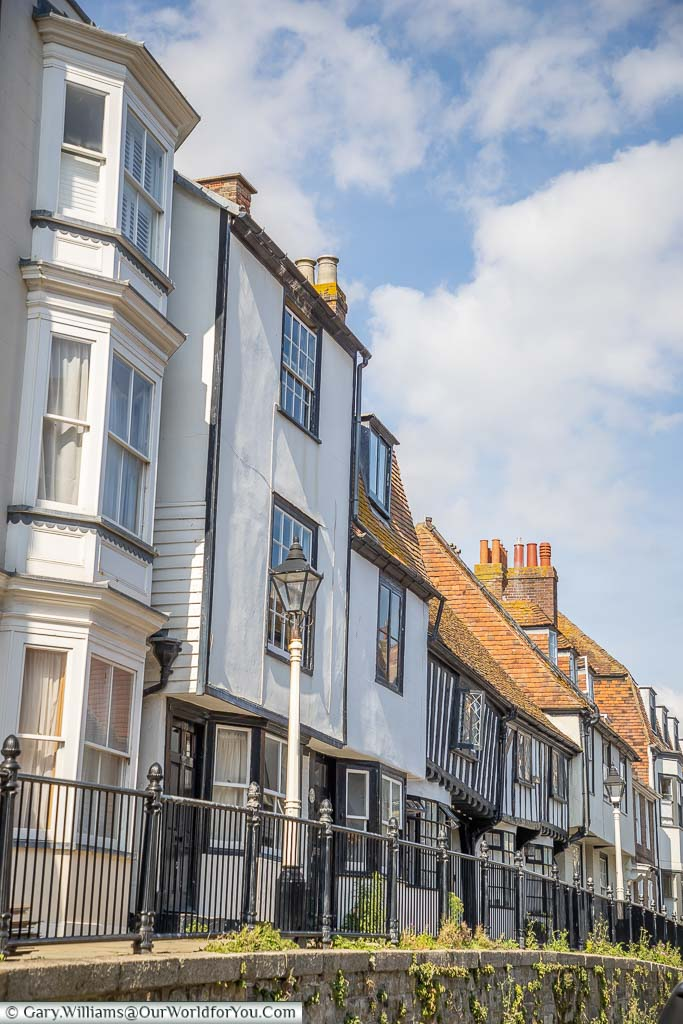 The mix of buildings along the historic terraced houses of Hastings High Street