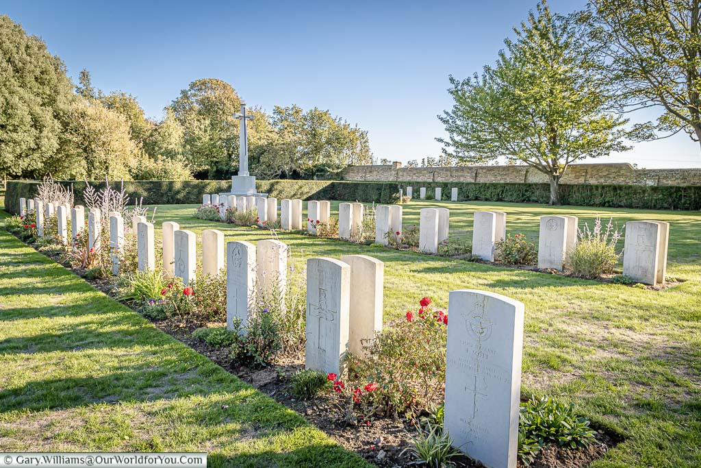 The Commonwealth War Graves section of Margate Cemetery with the Cross of Sacrifice in the far corner