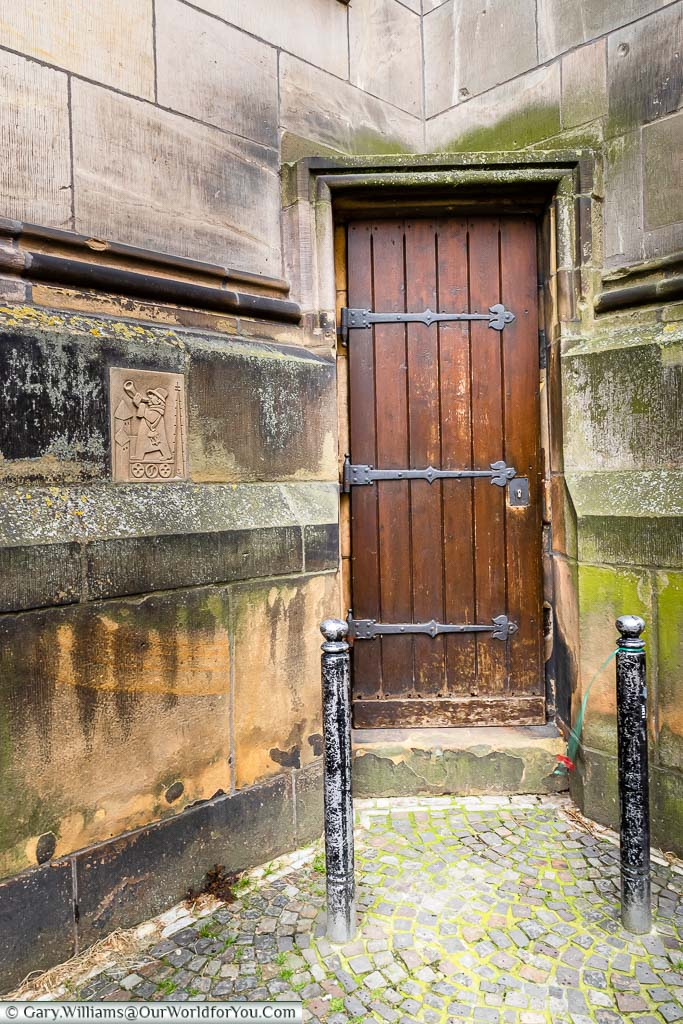 The wooden door at the base of the bell tower of St. Lamberti church. This discreet little entrance is the front door of the Tower Warden.
