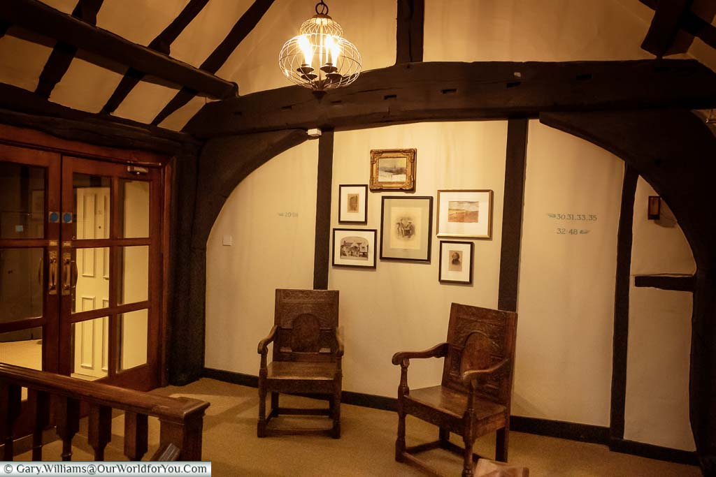 The first-floor lobby of the White Horse Hotel in Dorking at dusk.