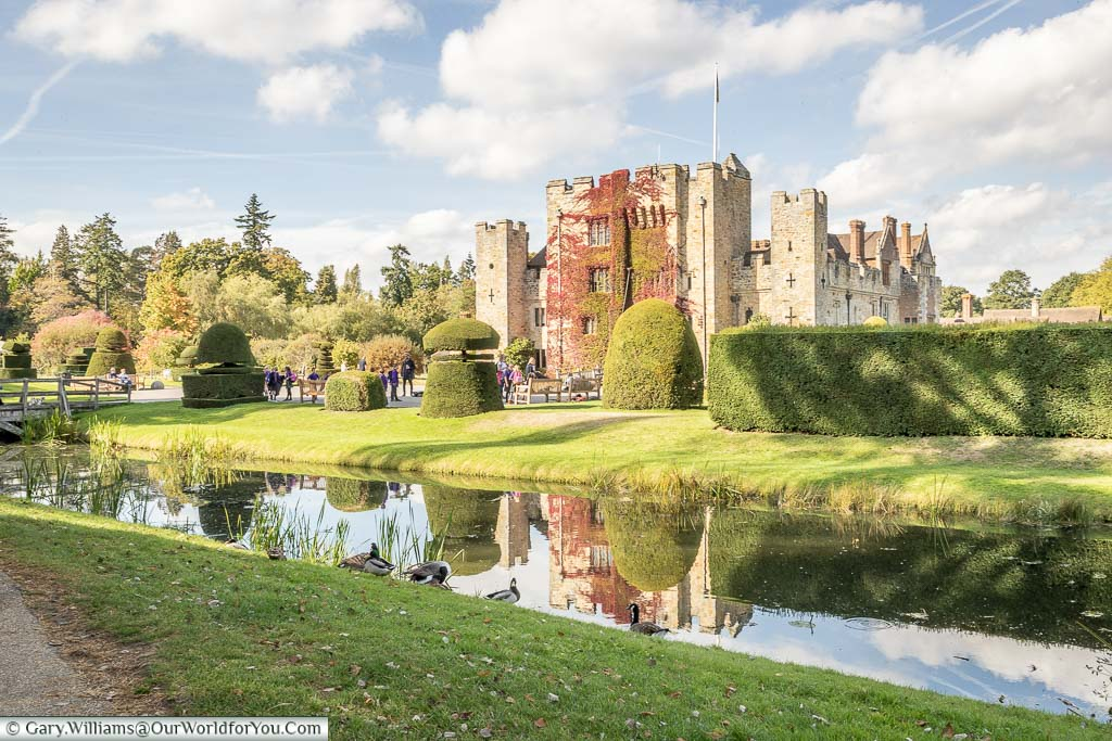 The beautiful Hever Castle on a bright, sunny, autumnal day from the edge of the second moat.
