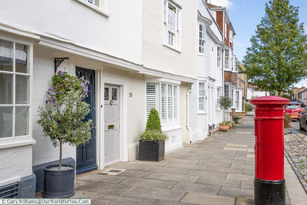 A bright red pillar box stands on the quaint Abbey Street in Faversham