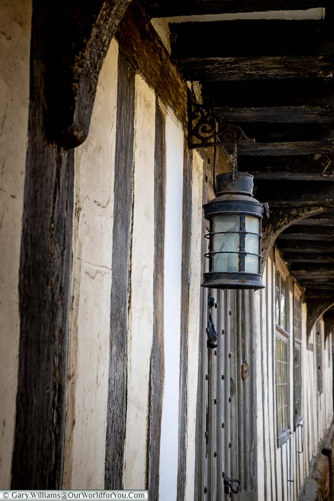 A close-up of an old lantern hanging from a half-timbered building on Upper Street, Hollingbourne