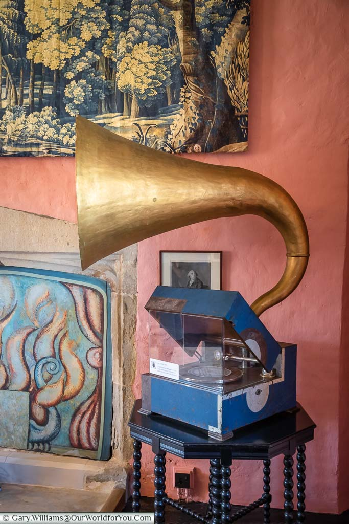 A 1930's gramophone with its large brass horn in the music room of the gatehouse tower of Knole house.