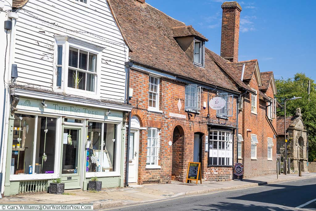 A picturesque street view of Faversham Road in Lenham with it's historic Red Brick buildings and the 18th-century mortuary