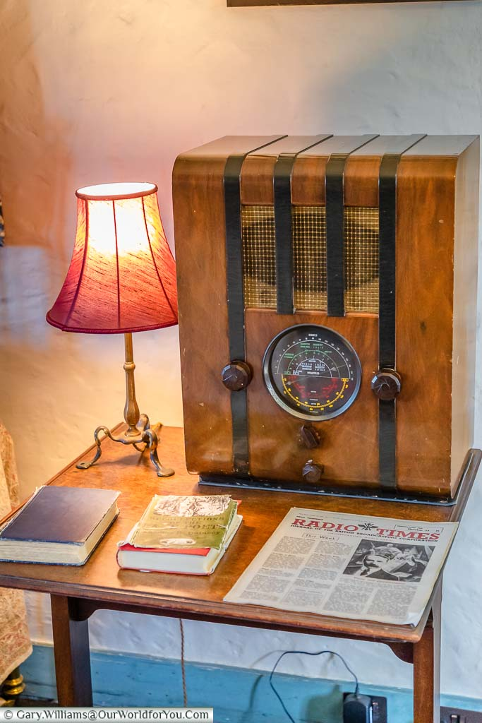 A 1930's vintage radio on a bedside table in Eddy Sackville-West's bedroom in the gatehouse tower of Knole house