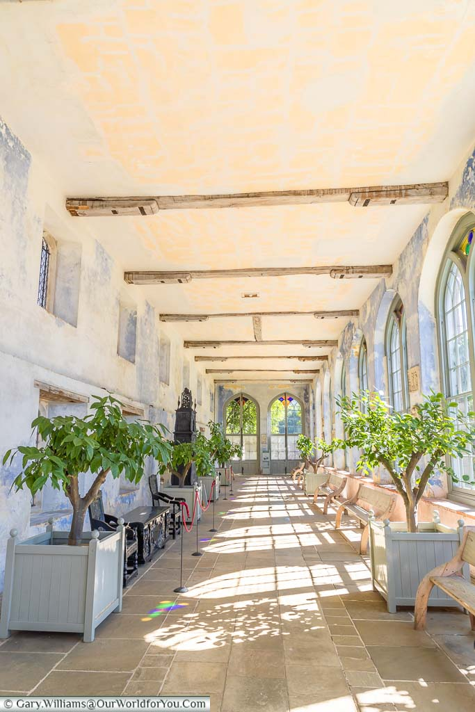 The long, narrow, brightly lit orangery at Knole painted in powder blue