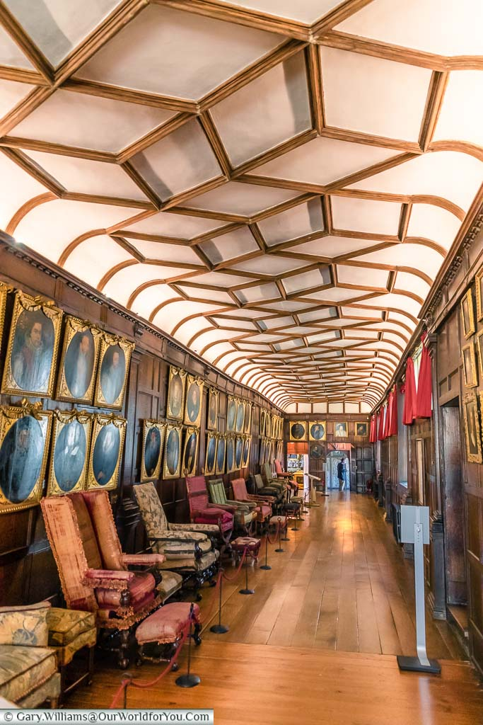 The long slender Brown Gallery, lined with portraits of dignitaries, in Knole House