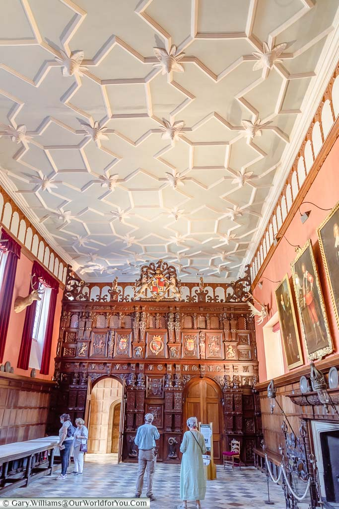 The immense ornamented oak screen at the end of the Great Hall at Knole House