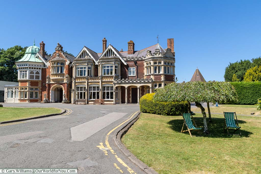 The Mansion at Bletchley Park, with deck chairs placed in the shade in the foreground.