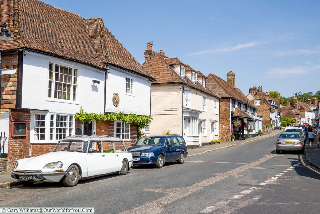 A lookup The High Street in Charing, Kent with its historic building and red tiles roofs