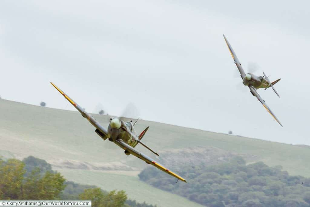 A World War 2 Spitfire & Hurricane flying over the West Sussex countryside
